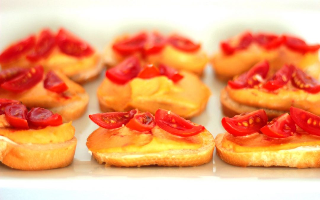 Red Pepper Hummus Topped with Baby Plum Tomato Wedges